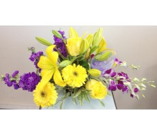Purple and Yellow Seasonal Arrangement